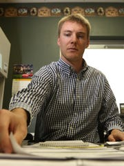 City Clerk Paul Przybelski works in his office at the