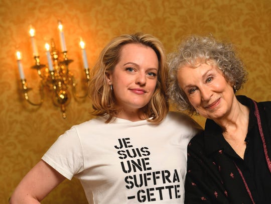 Elisabeth Moss and Margaret Atwood pose for photos