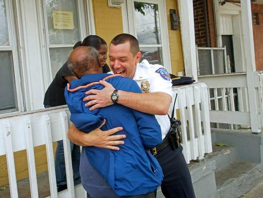 Wilmington police officer Lt. Dan Selekman gives a