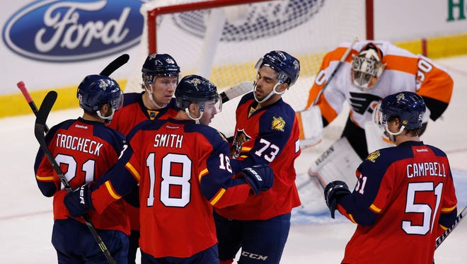 Florida Panthers right wing Reilly Smith (18) celebrates his second goal of the game with center Brandon Pirri (73) center Vincent Trocheck (21) left wing Jussi Jokinen (36) and defenseman Brian Campbell (51) as Philadelphia Flyers goalie Michal Neuvirth (30) reacts in the third period at BB&T Center.