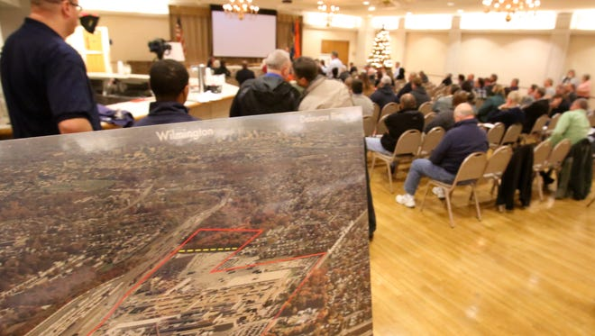 An aerial view of the Boxwood Road assembly plant is displayed as people attend a meeting about development plans for the site Thursday at the Fire Points Fire Company.