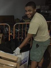 Guillermo Smith, 17, volunteers to take out the trash, clean bathrooms and help cook food in San Juan after Hurricane Maria's rampage.