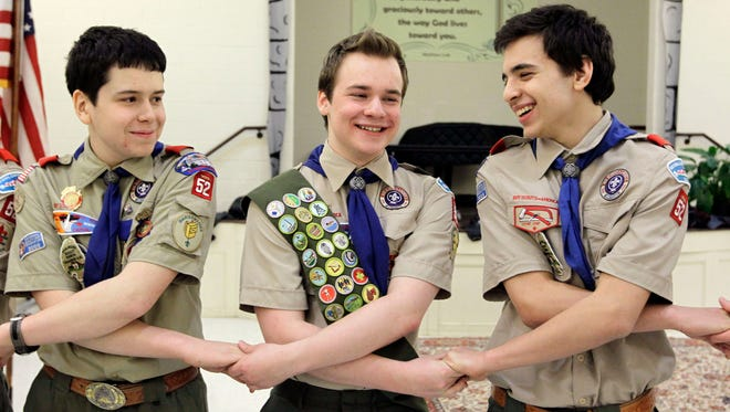 Pascal Tessier, center, takes part in an activity with fellow Scouts Matthew Huerta, left, and Michael Fine after he received his Eagle Scout badge on Feb. 10, 2014, in Chevy Chase, Md. On April 2 the Boy Scouts' New York chapter announced it hired Tessier as the nation's first openly gay Eagle Scout as a summer camp leader.