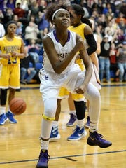 Lancaster Catholic's Kiki Jefferson celebrates after scoring and being fouled in this file photo from three years ago.