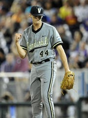 Vanderbilt pitcher Kyle Wright pumps his fist after defeating TCU 1-0 during the College World Series at TD Ameritrade Park, Tuesday, June 16, 2015, in Omaha, Neb.