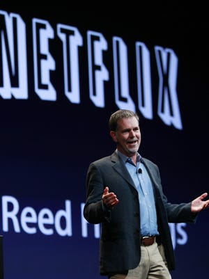Netflix CEO Reed Hastings greets the audience at the 2010 Apple Worldwide Developers Conference, in San Francisco. When he launched Netflix in 1998,, Hastings was hailed in Silicon Valley as a visionary. But, in some quarters, he was mocked for being delusional about the future of home entertainment. Hastings proved the haters wrong.
