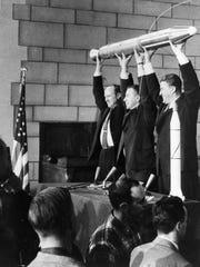 The three men responsible for the success of Explorer 1, America's first Earth satellite which was launched Jan. 31, 1958. At left is Dr. William Pickering, former director of JPL, which built and operated the satellite. Dr. James van Allen, center, of the State University of Iowa, designed and built the instrument on Explorer that discovered the radiation belts circling Earth. At right is Dr. Wernher von Braun, leader of the Army's Redstone Arsenal team which built the first stage Redstone rocket that launched Explorer 1.