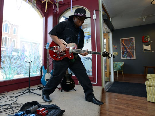 Zayne Harshaw plays guitar April 17 at Art and Clay on Main in downtown Lancaster. Harshaw also performs as part of Blues Spectrum.