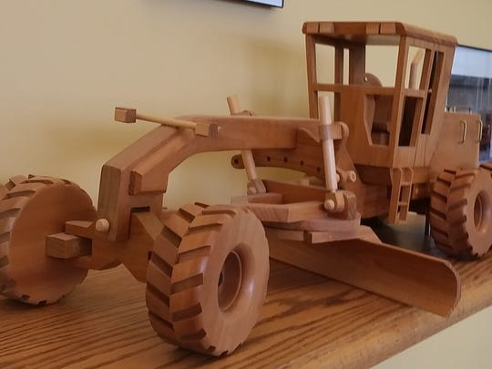This wooden model of a road grader was built by Dan Austad.