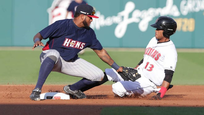 The Indianapolis Indian's Pedro Florimon is safe at second as he slides past the Toledo Mud Hen's #24, Jordany Valdespin, at Victory Field, Friday July 8th, 2016.