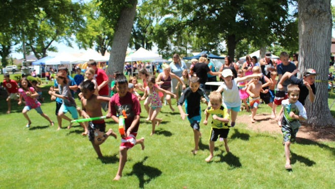 Kids enjoy a water fight during last year's Water Festival.