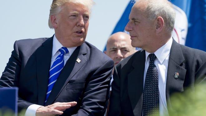 President Trump speaks with John Kelly.