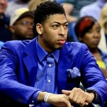 New Orleans Pelicans forward Anthony Davis sits on the bench during the first quarter of a game against the Los Angeles Clippers at the Smoothie King Center.