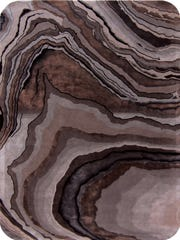 This photo provided by Marc Phillips Decorative Rugs shows the decorative rug, Topo, in smoke by Marc Phillips.