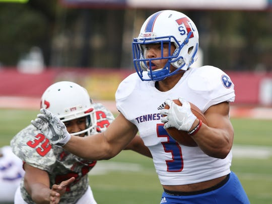 Tennessee State freshman Chris Rowland (3) escapes