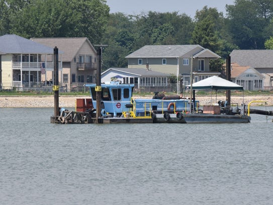 A dredge operates off of Liebs Island in Buckeye Lake on July 21, 2016.