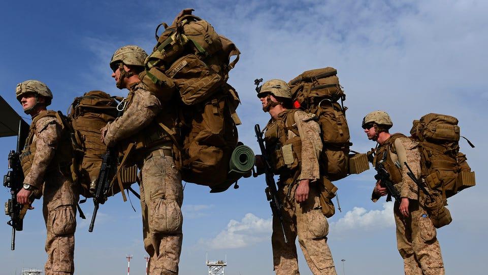 Marines board a C-130J Super Hercules transport aircraft