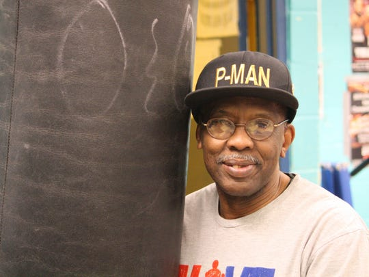 """Daryl """"Coach P-man"""" Jones at the Findlay Street Neighborhood House Jan. 14, 2015 where he's the head boxing coach. Jones trains young boxers in an effort to keep kids off the street."""