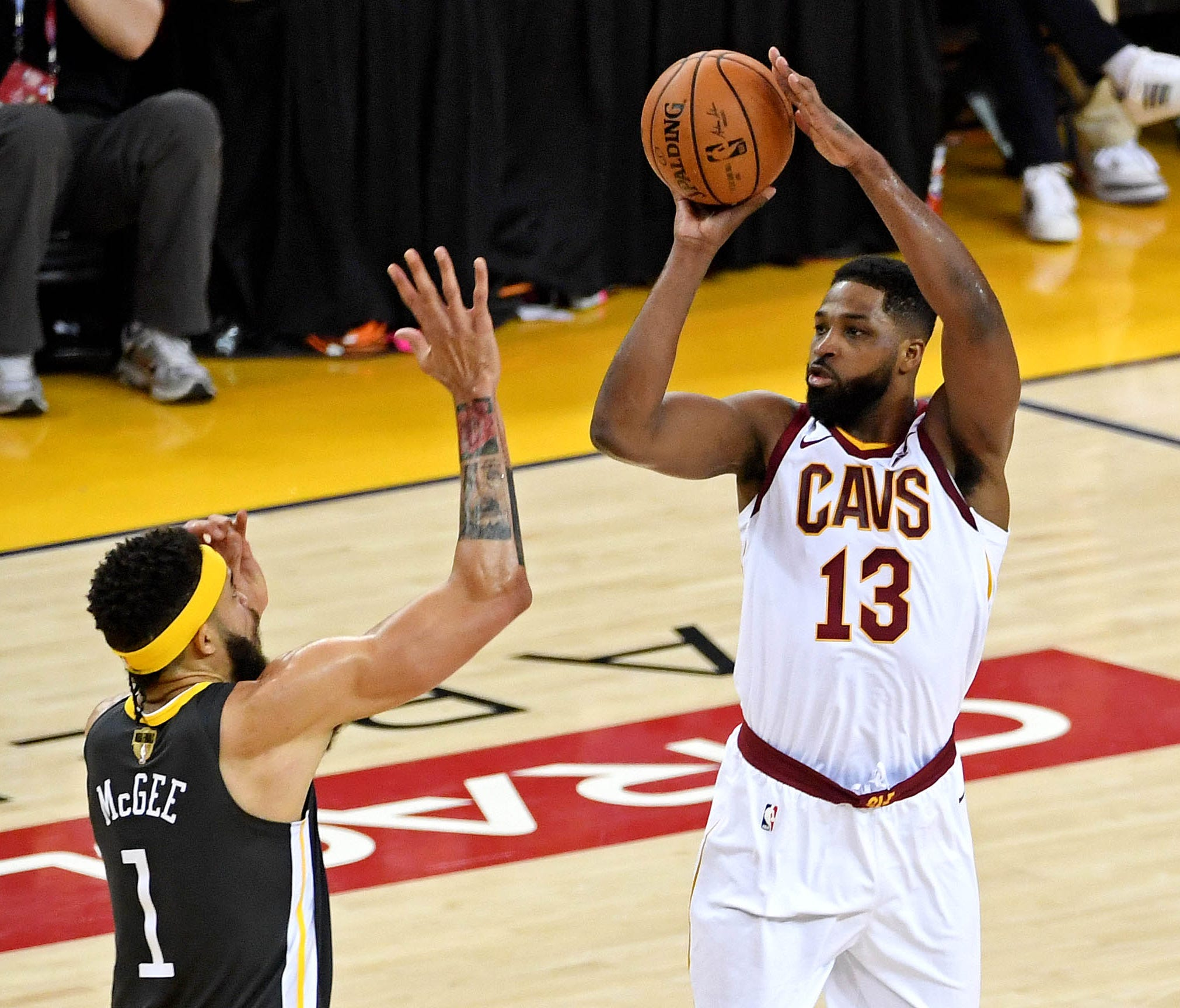 Cleveland Cavaliers center Tristan Thompson shoots the ball against Golden State Warriors center JaVale McGee during the first quarter in Game 2 of the NBA Finals.