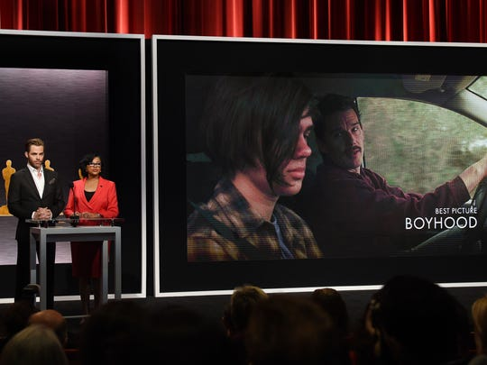"""Hosts Chris Pine and Academy President Cheryl Boone announce the movie """"Boyhood: as one of the Oscar nominees for Best Picture during the Academy Awards Nominations Announcement at the Samuel Goldwyn Theater in Beverly Hills, California on Jan. 15."""