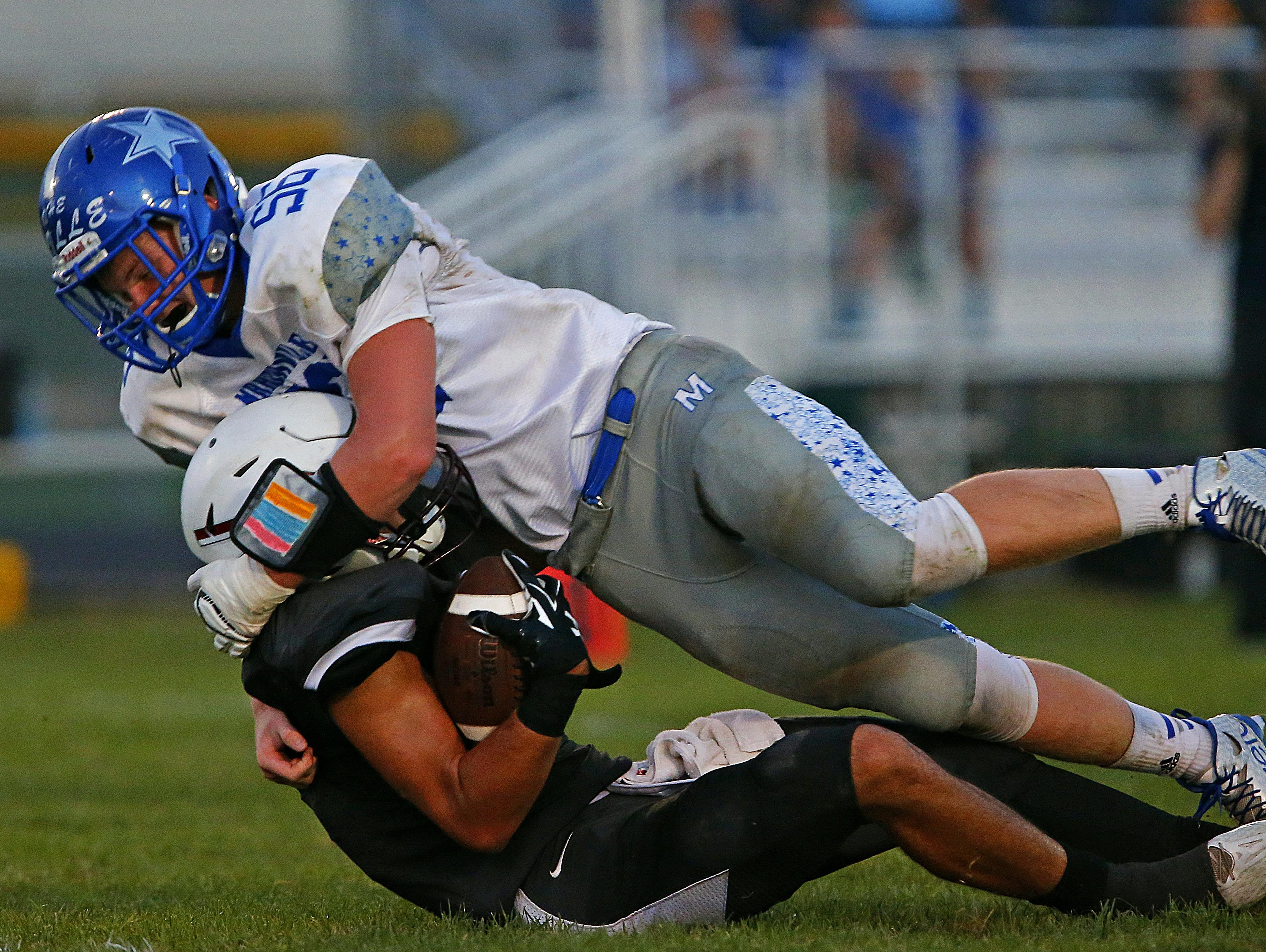Strafford High School wide receiver Brady Wilson (1) is tackled by Comet defender Waylon Davis (56) during second quarter action of the Indians' game against Marionville High School at Strafford High School in Strafford, Mo. on Sep. 4, 2015. Marionville won the game 28-6.