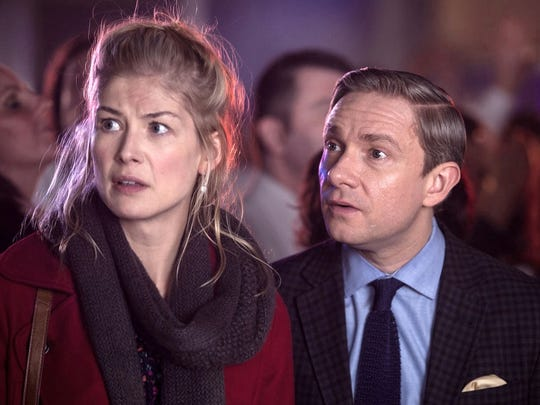 "Rosamund Pike and Martin Freeman battle aliens in ""The World's End"" (2013)."