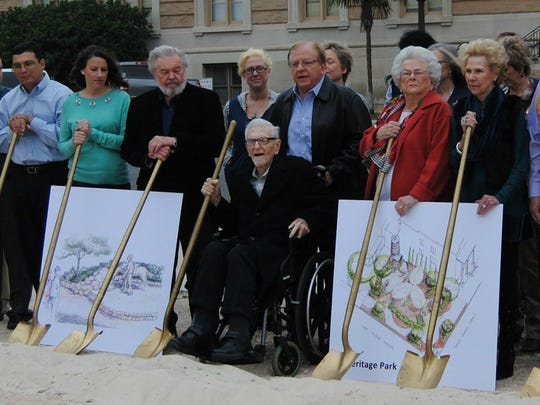 J.Willis Johnson (center, in wheelchair) donated land in downtown San Angelo that will soon be home to a heritage park. He is shown here at the groundbreaking in late 2017.