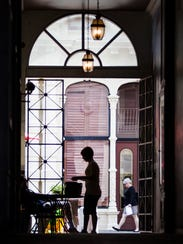 A woman stands in the walkway between the Chelsea Tavern