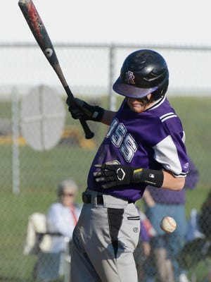 Fremont Ross' Travis Brown gets hit by a pitch during an at-bat during Tuesday's baseball game at Margaretta.