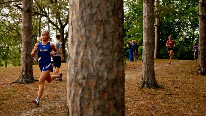 Cros-Lex's Calli Townsend runs during the Marysville Invitational cross country meet Thursday, October 8, 2015 at Marysville City Park.