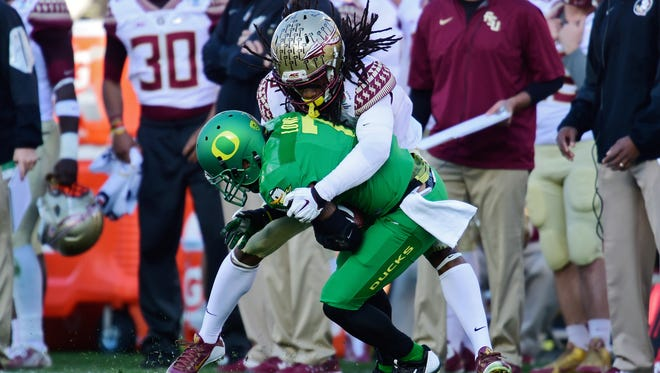 Oregon Ducks wide receiver Keanon Lowe (7) is tackled by Florida State Seminoles cornerback Ronald Darby (3) during the first half of the 2015 Rose Bowl.