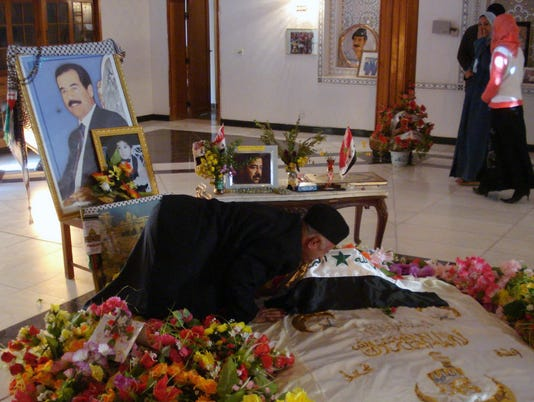 Report: Saddam's tomb ransacked, burned by militants