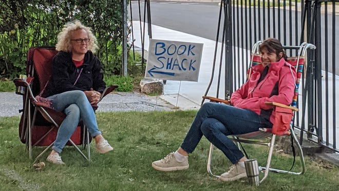 Wendy Holm,  of Northboro, and Laura Hamel, of West Boylston, enjoyed the socially-distanced concert in front of the Bigelow Free Public Library Monday. Hamel said Knock on Wood was 'fantastic.'
