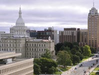 The state Capitol and Boji Tower dominate the downtown Lansing skyline.   Rod Sanford/Lansing State Journal The State Capitol Building and Boji Towe and other buildings  in downtown  Lansing.    Picture taken Thursday 9/11/2014.   Paige was adopted three years ago by the MSU football team as she battled brain cancer.  (Lansing State Journal | Rod Sanford)