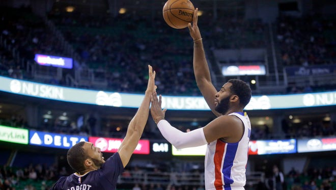 Detroit Pistons center Andre Drummond, right, shoots as Utah Jazz center Rudy Gobert (27) defends during the first half.