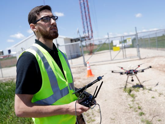 Alexander Ribeiro, certified UAS pilot and technical specialist for Nsight, talks on June 5, 2018 about how using a drone to examine cell towers can save time for crews in the field. Sarah Kloepping/USA TODAY NETWORK-Wisconsin