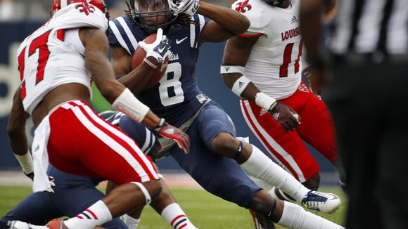 Mississippi's Quincy Adeboyejo (8) cuts back in an effort to find a hole to run through in an NCAA college football game against Louisiana-Lafayette in Oxford , Miss., Saturday, Sept. 13, 2014. (AP Photo/The Commercial Appeal, Jim Weber)