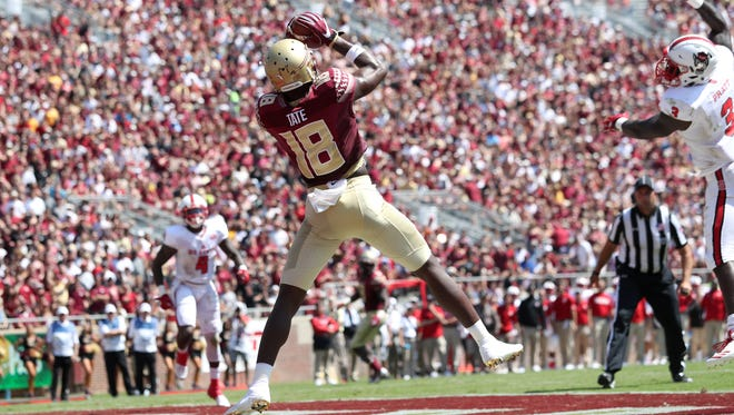 FSU's Auden Tate catches a touchdown pass from James Blackman against NC State during the Seminoles home opener at Doak Campbell Stadium on Saturday.