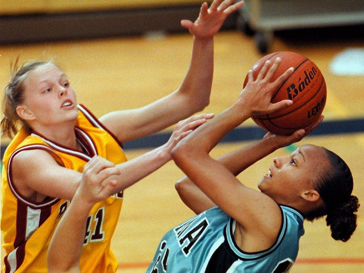 Roosevelt's Ashley Pederson (left) forces Buena's Courtney Young to alter her shot during the first quarter.