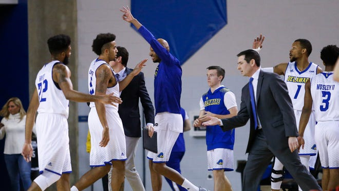 The Hens are greeted by coach Martin Ingelsby and the bench after building an 8 point lead in the first half at the Bob Carpenter Center Tuesday.