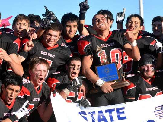 The Hatch Valley Bears celebrate winning the 2015 New Mexico 4A state championship.