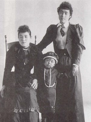 This is believed to be an 1894 photo of Toyo Watanabe, standing on the right, who was murdered in Salem the following year.