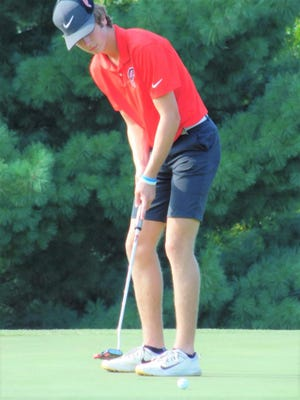 Pekin's Cooper Theleritis putts during the Dragons' win over East Peoria at Quail Meadows Golf Course.