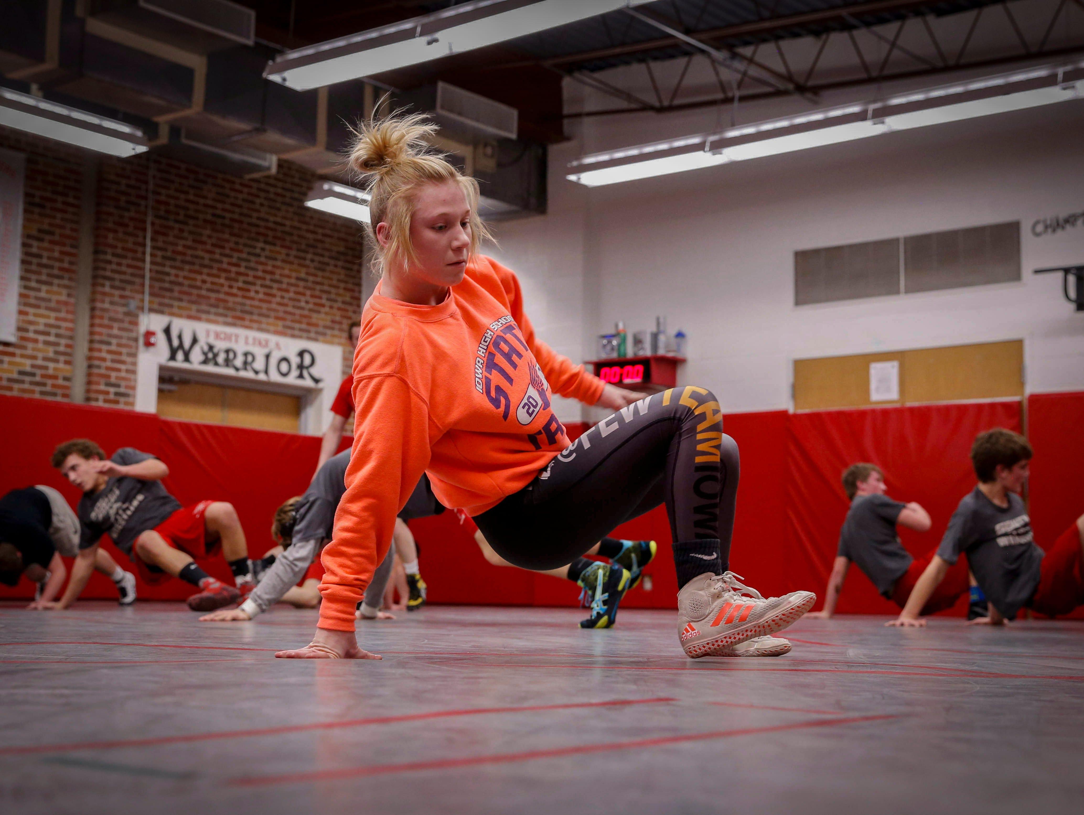 South Winneshiek junior wrestler Felicity Taylor works on techniques during practice on Tuesday, Jan. 31, 2017, at the South Winneshiek High School wrestling room in Calmar, Iowa.