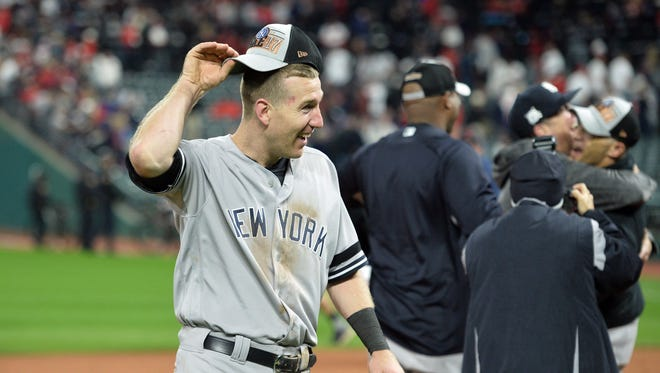 New York Yankees third baseman Todd Frazier (29) celebrates after defeating the Cleveland Indians in game five of the 2017 ALDS playoff baseball series at Progressive Field on Wednesday, Oct. 11, 2017.