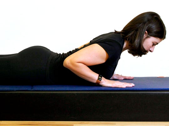 Erin Stern shows the ending position for the Pilates exercise, back extension.