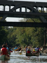 Members of the Mill Creek Yacht Club canoe on the Mill