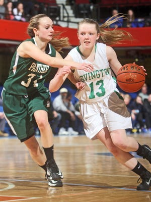Lindsay Halpin drives on Pleasantville's Annmarie DiCarlo as Irvington defeated Pleasantville 61-39 in a Class B girls basketball semifinal against Pleasantville at the Westchester County Center Feb. 24, 2015. Halpin finished with seventeen points.