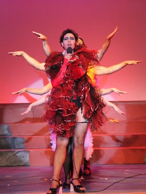 """Jay Poff goes all out as Frank 'N' Furter in """"Rocky Horror Show"""" at Barn Theatre."""