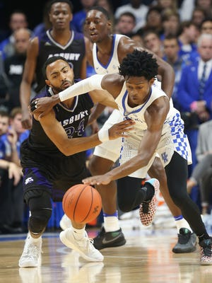 UK's De'Aaron Fox (0) tries to protect the ball against Asbury's Tyler Smith (24) during their game at Rupp Arena.Nov. 6, 2016